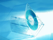 CD in blue tones. CD in box, on light blue background stock image