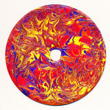 CD in bright colors. CD painted with bright primary colors Stock Photos