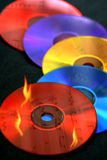 CD Burning. A conceptual image created to illustrate the concept of CD burning/ copying music onto CDs Royalty Free Stock Photos