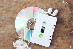 Cd with cassette tape. On rusty wooden background stock photo