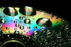 CD-Cleaning. Some water drops on a blank CD stock image