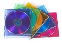 CD colorido, discos de DVD em umas caixas de cor Imagem de Stock