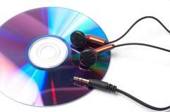 CD com música e fones de ouvido Fotos de Stock Royalty Free