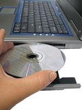 Cd on computer. Placing cd in computer's cd rom Royalty Free Stock Photo
