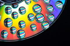 CD con gotas coloreadas Imágenes de archivo libres de regalías