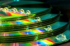 CD con las gotitas de agua fotografía de archivo libre de regalías