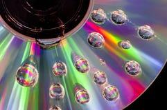 CD con las gotitas de agua foto de archivo