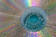CD con los waterdrops Fotos de archivo libres de regalías