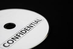 CD confidenziale sul nero Fotografia Stock