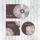 CD cover design template with floral mandala style on the wood t Royalty Free Stock Photography