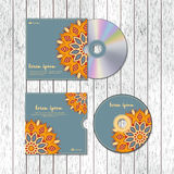 CD cover design template with floral mandala style on the wood t Stock Images