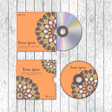 CD cover design template with floral mandala style on the wood t Royalty Free Stock Photos