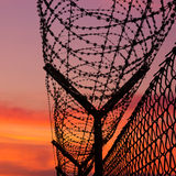 CD cover front - sunset behind a barbwire. Cd cover in standard proportion, sunset behind the barbed wire Stock Images
