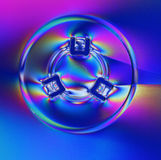 CD cover in polarized light. An abstract view of the center of a cover for a compact disk in polarized light Royalty Free Stock Photo