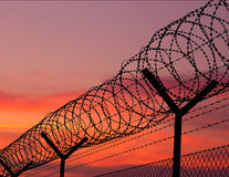 CD cover rear - sunset behind a barbwire Stock Photography