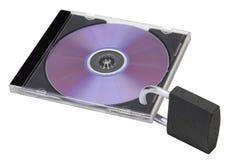 CD dans un cas transparent avec un blocage Photographie stock