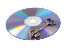 CD de blanc avec la clé Images stock
