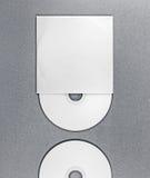 CD de blanc sur le gris Images libres de droits