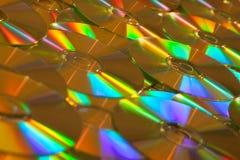 Cd de données ou fond d'or de DVDs Photos stock
