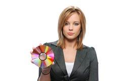 CD della holding della donna di affari Immagine Stock