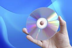 CD della holding della mano Immagine Stock