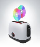 CD disc flying out of toaster, concept future burn Stock Photo
