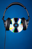 CD disc with headphones Royalty Free Stock Photos