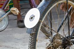Cd disc on rear mudguard of bicycle, used as reflector. Thailand Royalty Free Stock Photography