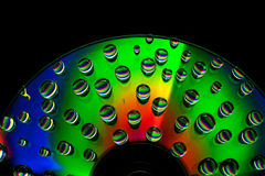 CD disc with water drops Stock Photos