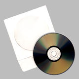 CD disk. CD with a paper envelope on a grey background. The background homogeneous, allows to continue it easily Royalty Free Stock Photography