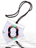 CD Disk cut-away on a cord stock photos