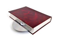 CD-disk embedded in the book Royalty Free Stock Images