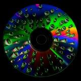 CD diskett med vattendroppar arkivbilder