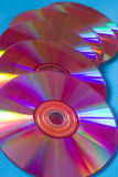 Cd disks. Six pink cd-disks on a blue background Royalty Free Stock Photography