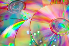 CD disks with rainbow reflection. Lots of CD DVD disks with rainbow reflection Royalty Free Stock Images