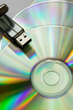 Cd disks with USB flash Royalty Free Stock Photography