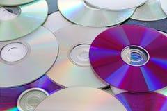 CD, dos dvds brilhantes reflexivos do CD do dvd teste padrão azul da textura do raio Foto de Stock Royalty Free
