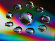 Cd drops. Drops of water on a cd\'s surface Royalty Free Stock Image