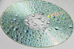 CD with drops of water royalty free stock photography
