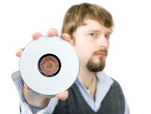 Cd or dvd. Man displaying cd or dvd, focused on cd stock images