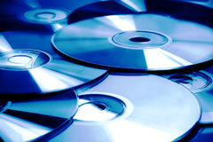 CD & DVD. Background of CD and DVD in blue royalty free stock image