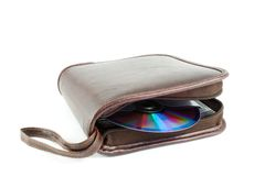 CD & DVD bag. From the brown leather with one DVD isolated on white stock images