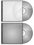 CD DVD cases and discs. Two CD or DVD cases with discs in them. One case is slightly transparent Stock Photo
