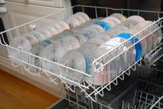 Cd / Dvd cleaning. Washing cd / Dvd`s in  dishwash machine Stock Photos