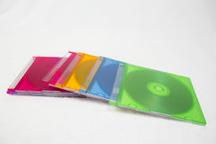 CD or DVD compact discs. Background of some colorful CD or DVD compact discs. discs in boxes isolated on white background Stock Photo