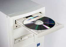 CD or DVD and Computer. CD/DVD being being inserted into a computer Stock Images