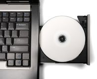 Inserting CD / DVD in Laptop Drive royalty free stock photo