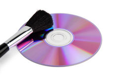 CD / DVD data disk and cleaning brush Royalty Free Stock Images