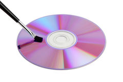CD / DVD data disk and cleaning brush Stock Photography