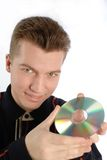 CD or DVD disc in hand. Young guy holds in hands  compact disk (CD and DVD) on  white background, close-up Stock Photos